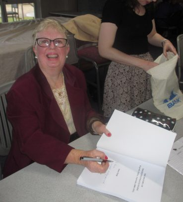 Anne signing the book